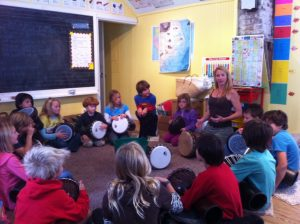 Drum circle with volunteer teacher, Christine